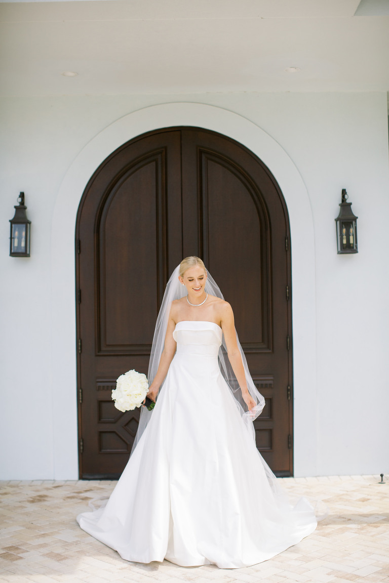 Elegant Bride in Classic Strapless Ballgown Crepe Romona Keveza Wedding Dress Holding Classic White Floral Bouquet | Luxury Tampa Wedding Planner Parties A'la Carte