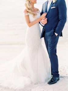 Bride and Groom Wedding Portrait in Navy Blue Suit and Ivory Lace Mermaid Wedding Gown