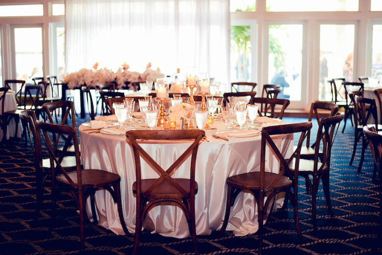 Luxury Florida Waterfront Wedding Reception With Ivory And White Silk Table Linens Candles Wooden
