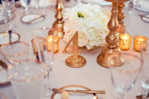 Luxury Florida Waterfront Wedding Reception Gold Table Numbers with Gold Candle Holders and White Hydrangea and Rose Floral Decor | Florida Wedding Planner Parties A La Carte | Clearwater Beach Wedding Venue Carlouel Yacht Club