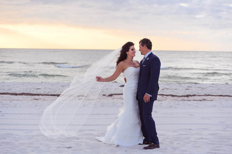 Florida Beach Wedding Portrait of Bride and Groom in the Sand | Luxury Florida Beach Waterfront Wedding | Florida Wedding Planner Parties A La Carte