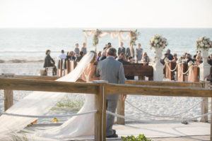 Bride Walking Down the Aisle with Father | Waterfront Clearwater Beach Ceremony | Planner Parties a la Carte
