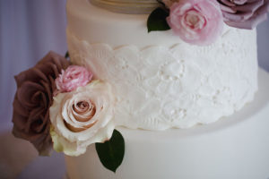 3-Tier White Wedding Cake with Dusty and Blush Pink Roses and Lace Appliqué